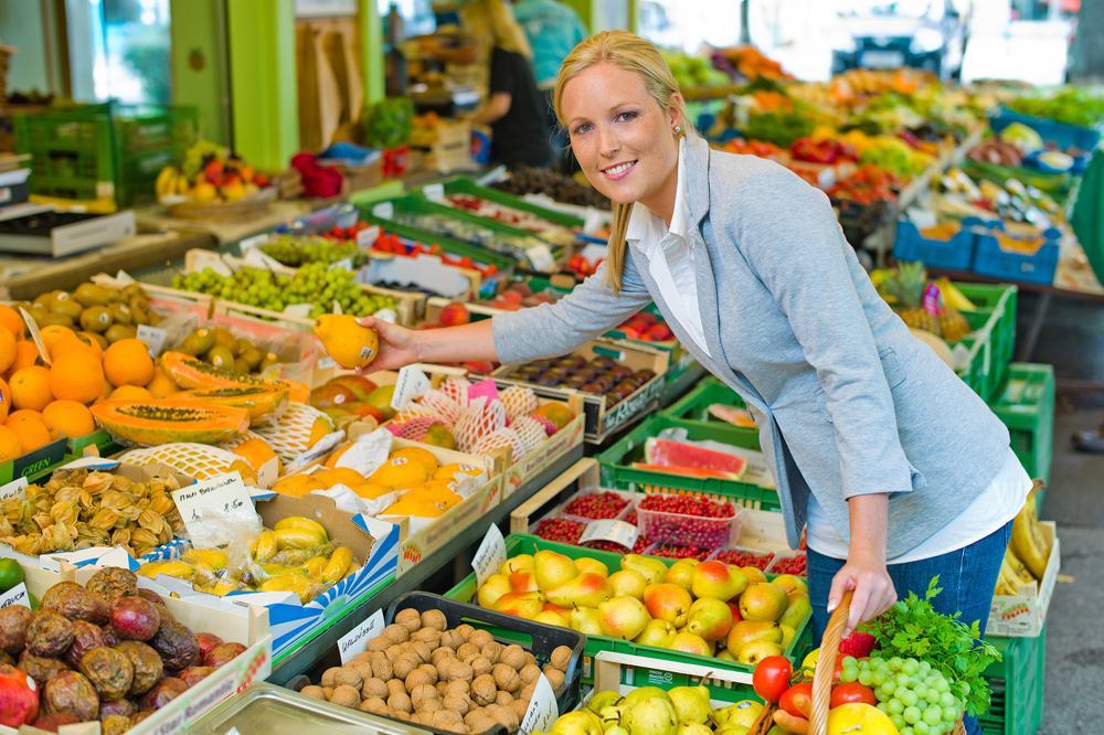 woman shopping for veggies and fruits
